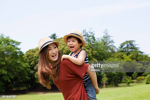 Mom that piggyback ride the children
