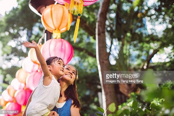 Mom & toddler admiring Chinese lanterns
