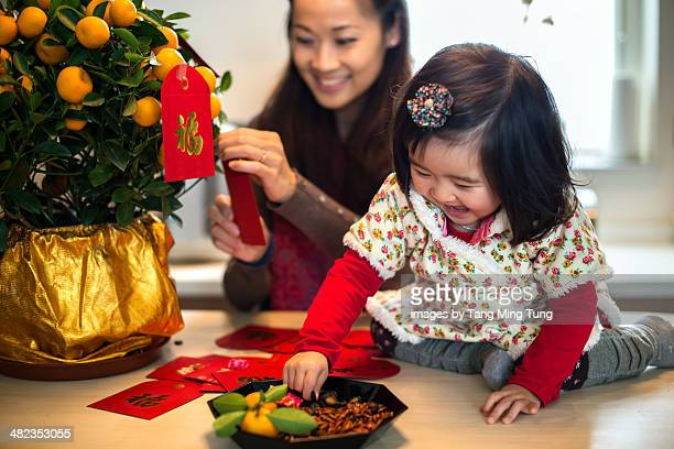 Mom & toddler preparing Chinese New Year joyfully