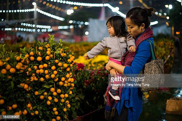 Mom & toddler shopping at lunar new year fair