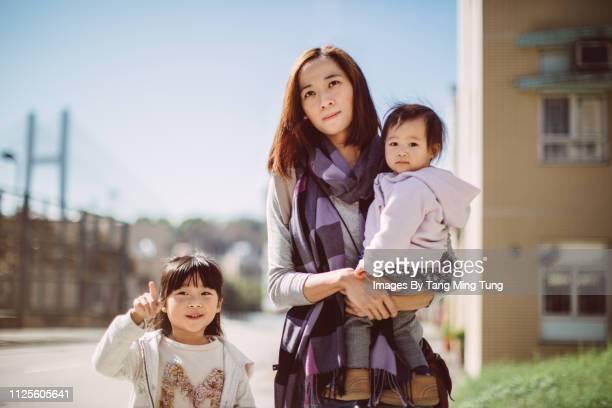 Mom travelling with her children joyfully.