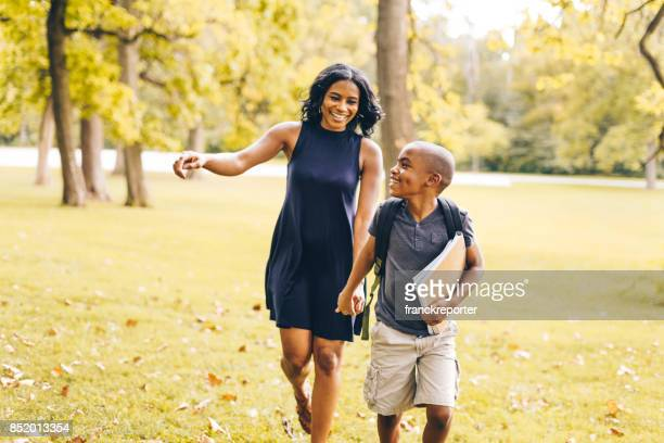mom walking with his soon before school - first day of summer stock pictures, royalty-free photos & images