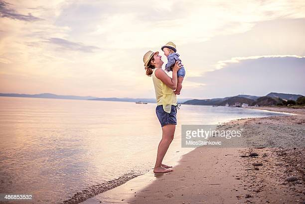 Mom with baby on the beach