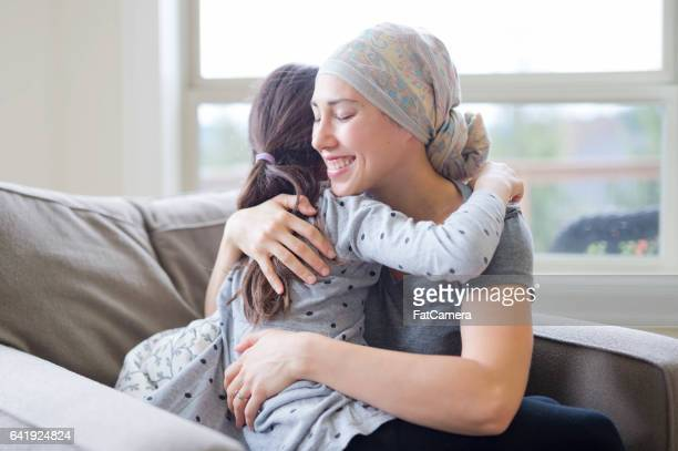 Mom with cancer holding daughter