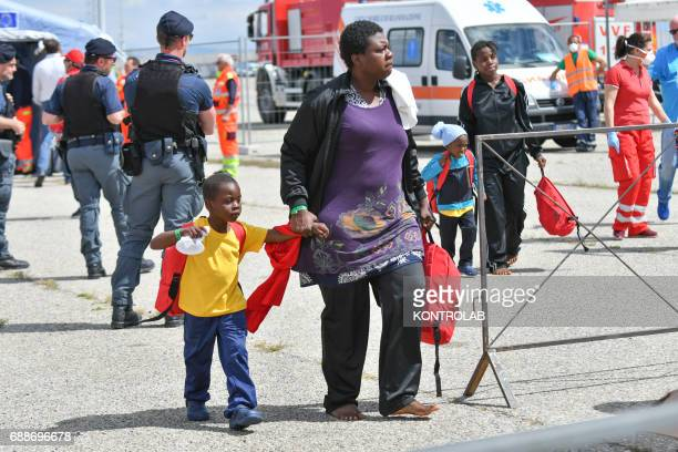 PORT CORIGLIANO CALABRIA ITALY A mom with her child during the landing of migrants from Vos Hestia ship in the port of Corigliano Calabria southern...