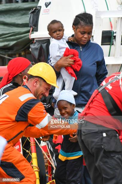 PORT CORIGLIANO CALABRIA ITALY A mom with two children during the landing of migrants from Vos Hestia ship in the port of Corigliano Calabria...