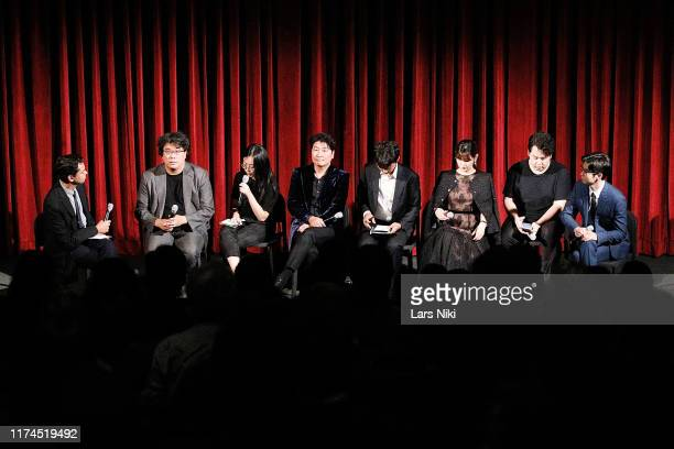 MoMA chief curator of film Rajendra Roy director Bong Joonho and actors Song Kangho Park Sodam and Choi Wooshik on stage during The Academy of Motion...