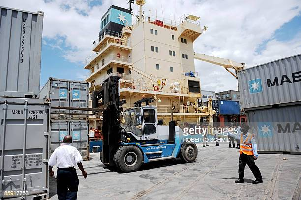 Mombasa port personnel in an effort to block access to the boat by journalists stack up empty containers around the dock where the US merchant ship...