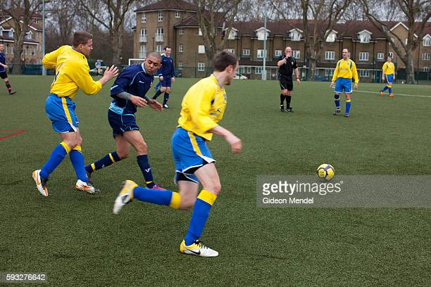 Moment of conflict during a Sunday league football game takes place at the football pitch in Mabley Green, close to the main site of the 2012 Olympic...