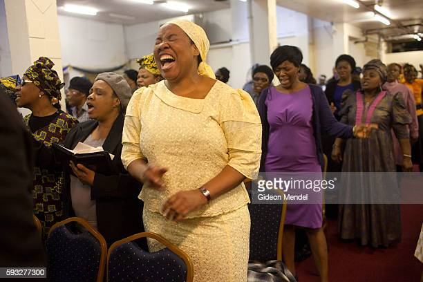 A moment of intense prayer at the Mountain of Fire and Miracles Ministries Church This Pentecostal church has grown from modest beginnings in Nigeria...