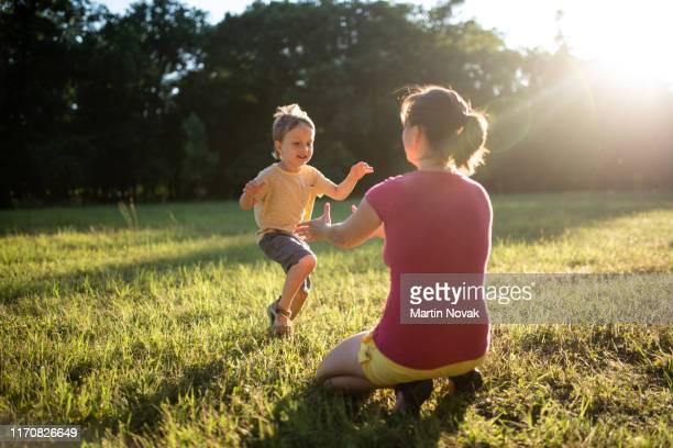 moment of love and family bonding captured - parque natural fotografías e imágenes de stock