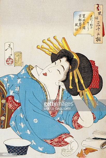 A moment of relaxation face of a Kansei period Geisha from Kyoto illustration by Tsukioka Yoshitoshi from Thirtytwo aspects of customs and manners...