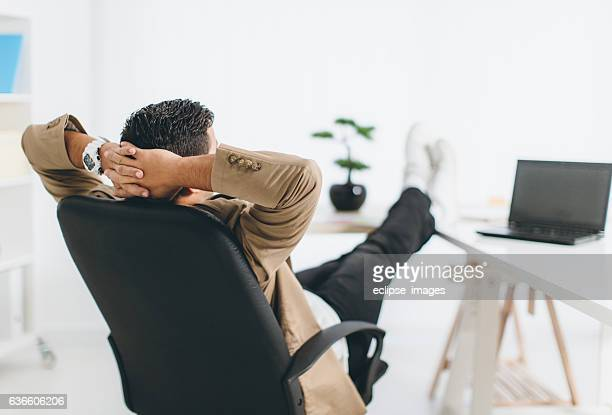 moment of relaxation - office chair stock pictures, royalty-free photos & images