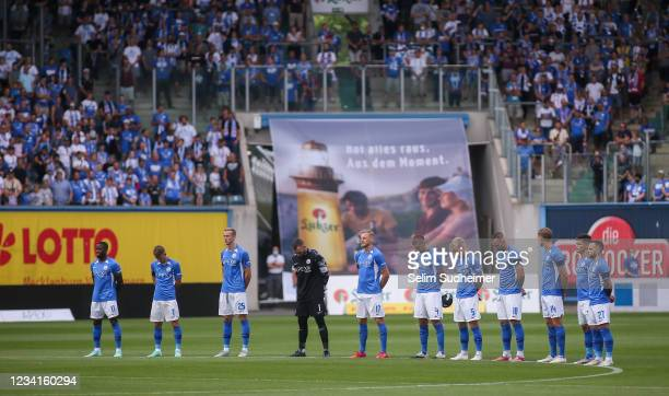 Moment of silence for the victims of the flood during the Second Bundesliga match between FC Hansa Rostock and Karlsruher SC at Ostseestadion on July...