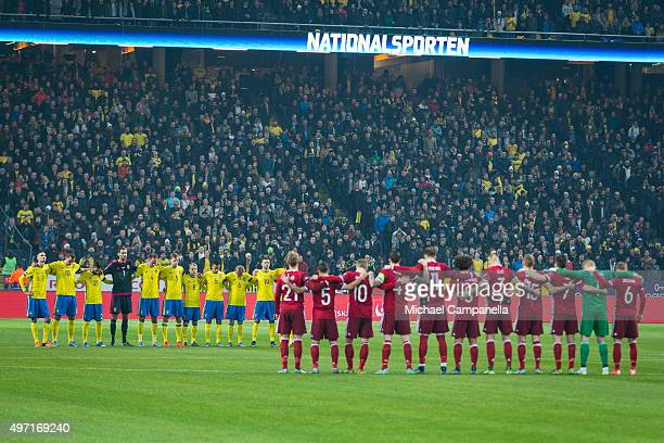 A moment of silence for the victims of the Paris attack is observed at the start of the European Qualifier PlayOff between Sweden and Denmark on...