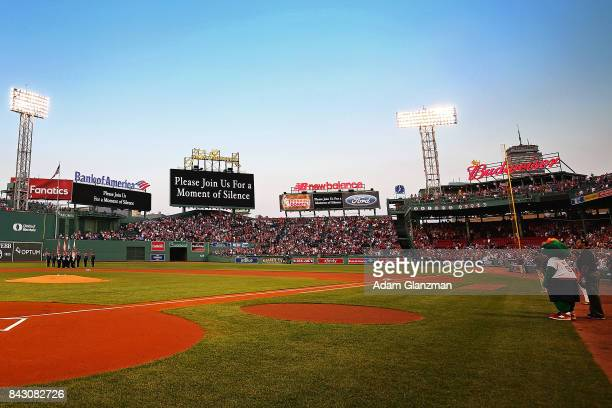 A moment of silence is held for the victims of Hurricane Harvey before a game between the Boston Red Sox and the Toronto Blue Jays at Fenway Park on...