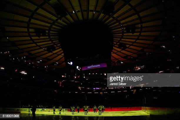 A moment of silence is held in honor of Belgium prior to the NHL contest between the New York Rangers and the Boston Bruins at Madison Square Garden...