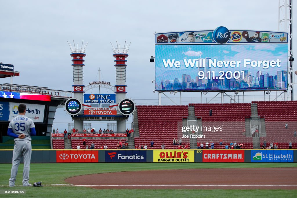 A moment of silence is held to mark the anniversary of September 11 prior to the game between the Los Angeles Dodgers and Cincinnati Reds at Great American Ball Park on September 11, 2018 in Cincinnati, Ohio.