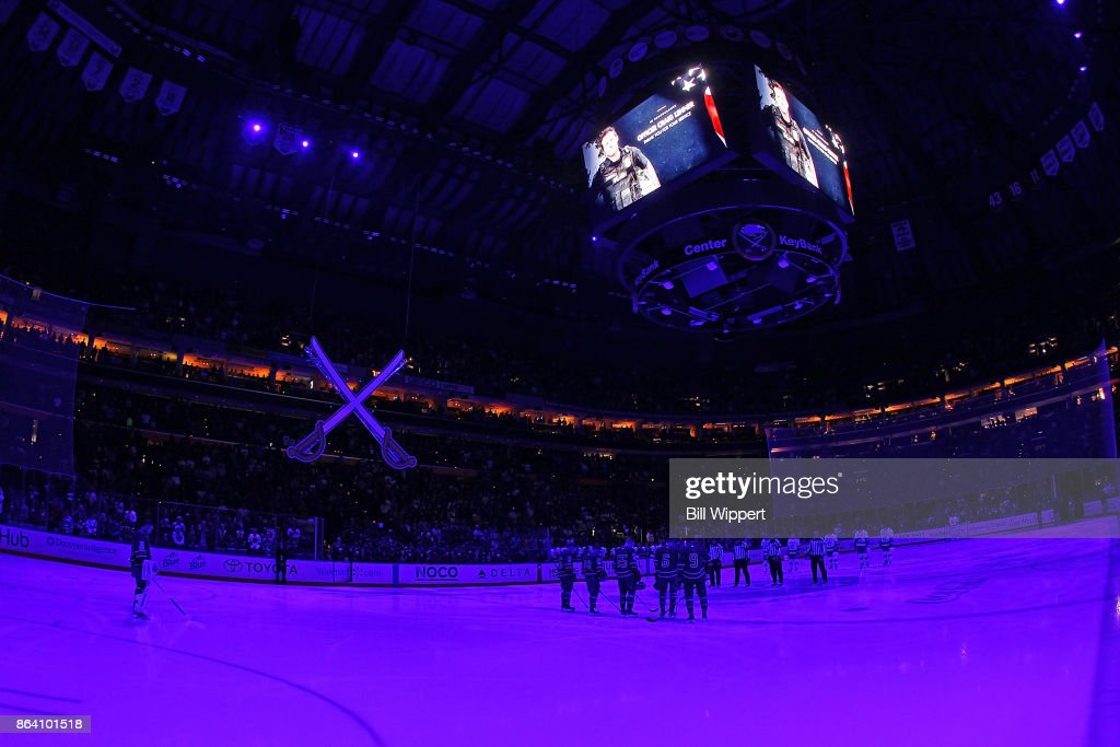 A moment of silence is observed for fallen Buffalo Police Officer Craig E. Lehner prior to the NHL game between the Buffalo Sabres and the Vancouver Canucks at KeyBank Center in Buffalo, New York.