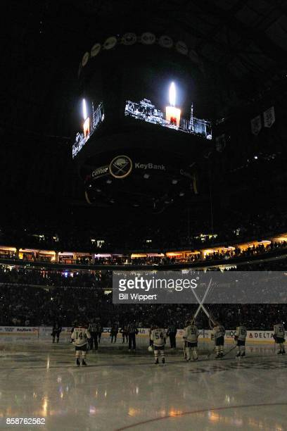 A moment of silence is observed for the victims of the Las Vegas tragedy before an NHL game between the Buffalo Sabres and the Montreal Canadiens on...