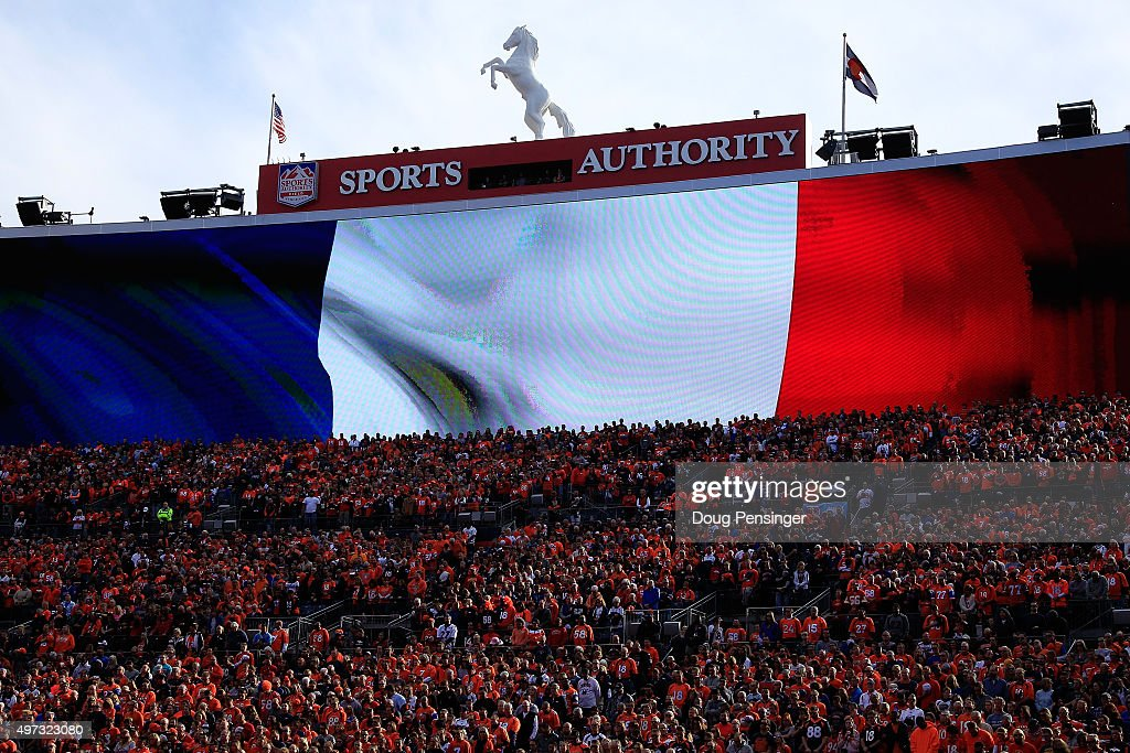 A moment of silence is observed in honor of the victims of the recent terrorist attacks in Paris prior to the game between the Kansas City Chiefs and the Denver Broncos at Sports Authority Field at Mile High on November 15, 2015 in Denver, Colorado. The Chiefs defeated the Broncos 29-13.