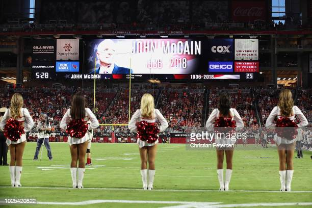 A moment of silence is observed to honor the passing of Arizona senator John McCain before the preseason NFL game between the Arizona Cardinals and...