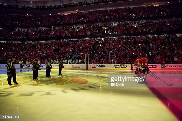 A moment of silence is taken for the victims of the attack in Brussels Belgium during pregame ceremonies of the NHL game between the Chicago...