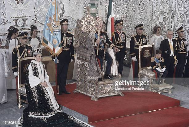 A moment of the coronation of Iran Shah Mohammad Reza Pahlavi and his third wife Farah Pahlavi On the right there is Shah's son Reza Pahlavi Tehran...