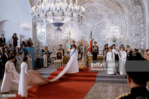 A moment of the The coronation of the Shah of Persia Mohammed Farah Pahlavi and his family One can recognise with her back turned with a long...