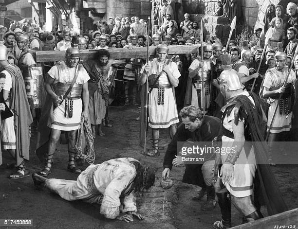 Moment of Tragedy. In this highly dramatic scene from MGMS Ben-Hur, Charlton Heston, in title role, is trying to give Jesus a drink of water after He...
