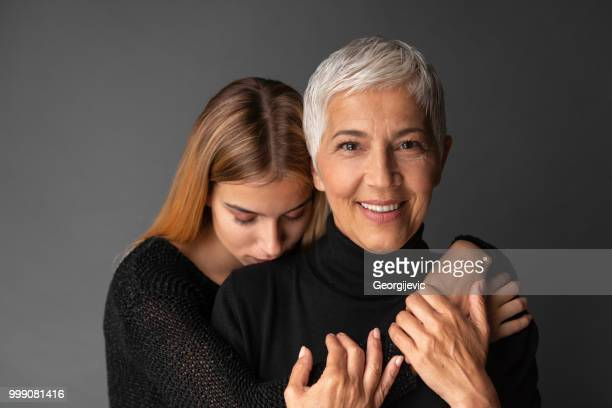 moment with mother - beautiful granny stock photos and pictures