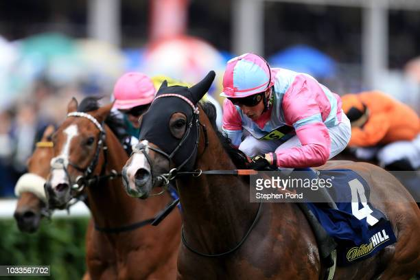 Momentofmadness ridden by jockey William Buick wins the William Hill Portland Handicap Stakes at Doncaster Racecourse on September 15 2018 in...