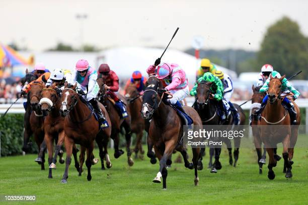 Momentofmadness ridden by jockey William Buick wins the William Hill Portland Handicap Stakes at Doncaster Racecourse on September 15, 2018 in...