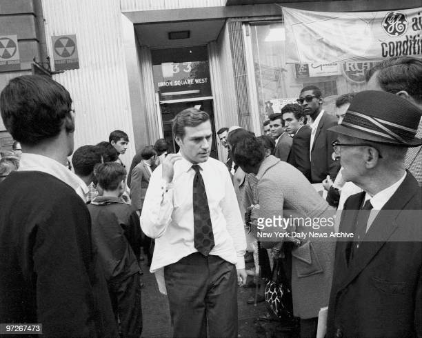 Moments after Andy Warhol was critically shot at his 33 Union Square office his associate Mario Amaya walks to ambulance with back wound Bullet...