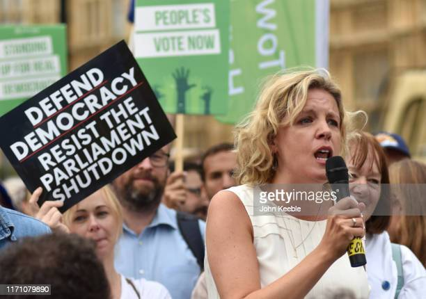 Momentum coordinator Laura Parker speaks to protesters as they gather in Westminster to protest against the government proroguing parliament on...