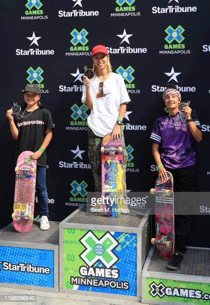 Momiji Nishiya of Japan second place Aori Nishimura of Japan first place and Mariah Duran of Brazil third place celebrate on the podium for the...