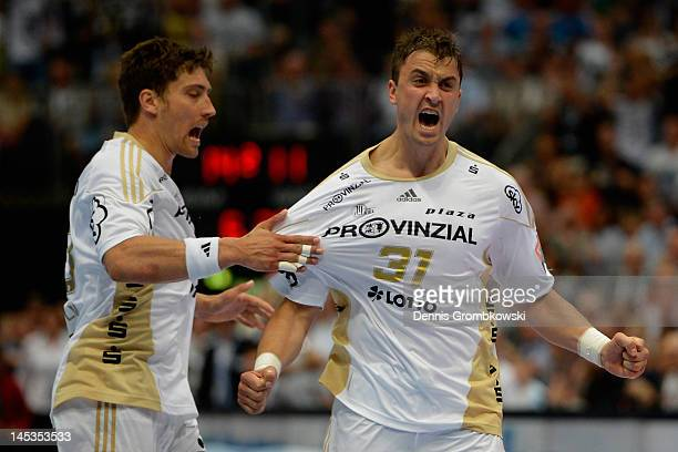 Momir Ilic of Kiel celebrates with teammate Marcus Ahlm after scoring during the EHF Final Four final match between THW Kiel and BM Atletico Madrid...