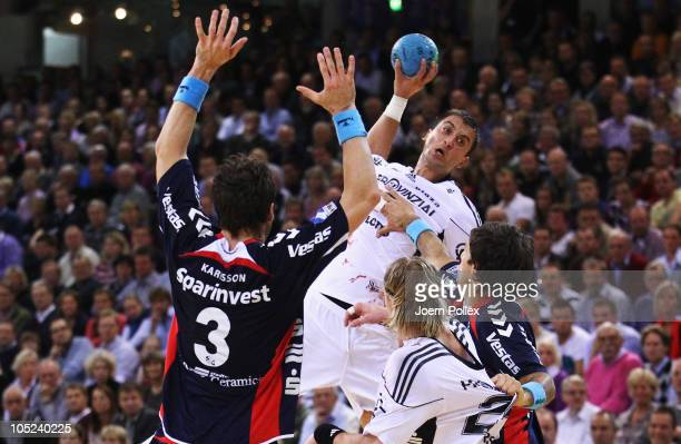 Momir Ilic of Kiel scores during the Toyota Handball Bundesliga match between SG FlensburgHandewitt and THW Kiel at the Campus Hall on October 13...