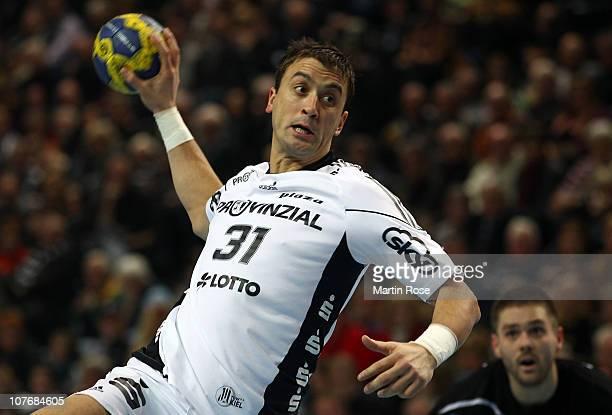 Momir Ilic of Kiel throws at goal the Toyota Handball Bundesliga match between THW Kiel and VfL Gummersbach at the Sparkassen Arena on December 19...