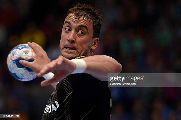 Momir Ilic of Kiel throws the ball during the EHF Final Four third place match between KS Vive Targi Kielce and THW Kiel at Lanxess Arena on June 2...