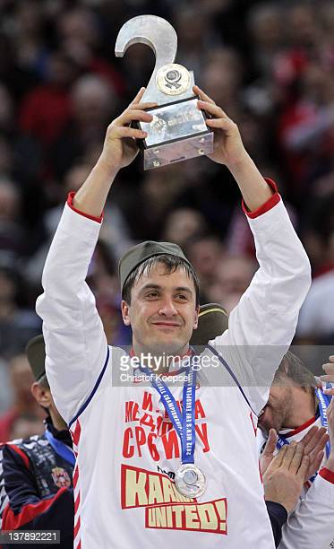 Momir Ilic of Serbia poses with the trophy for the second place on the podium after losing 1921 the Men's European Handball Championship final match...