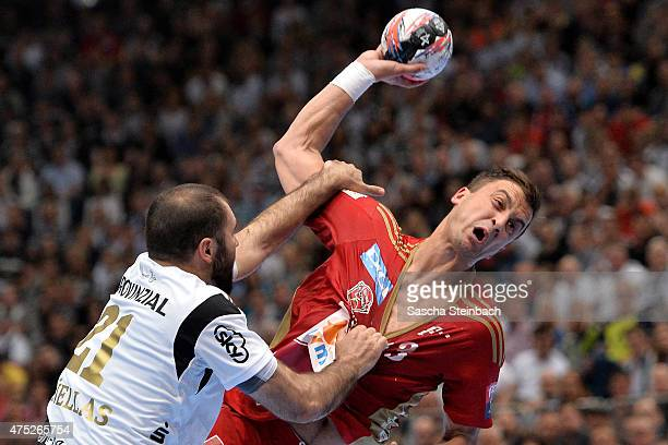 Momir Ilic of Veszprem and Joan Canellas Reicach of Kiel battle for the ball during the 'VELUX EHF FINAL4' semi final match between THW Kiel v MKBMVM...