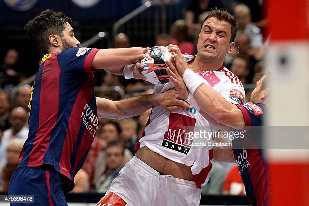 Momir Ilic of Veszprem battles for the ball during the 'VELUX EHF FINAL4' final match between FC Barcelona and MKBMVM Veszprem at Lanxess Arena on...