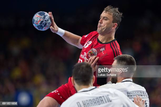Momir Ilic of Veszprem throws the ball during the VELUX EHF FINAL4 Semi Final match between Telekom Veszprem and Paris SaintGermain Handball at...