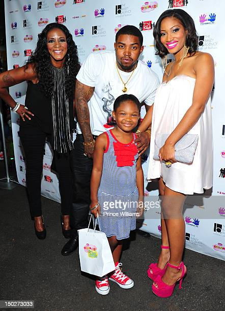 Momma Dee Lil Scrappy Emani Richardson and Erica Dixon attend the Runway Red Celebrity Kids fashion show at Zoo Atlanta on August 11 2012 in Atlanta...