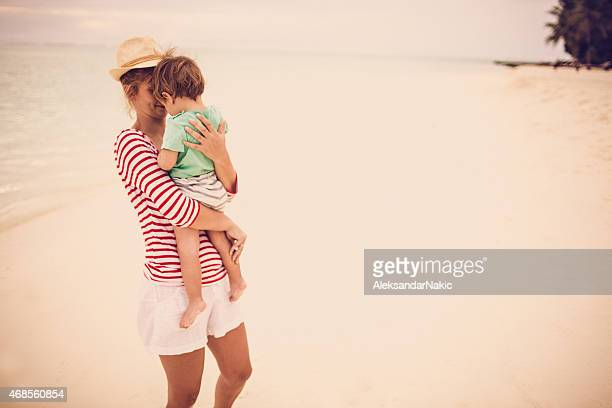 mommy and baby boy at the beach - mothers day beach stock pictures, royalty-free photos & images