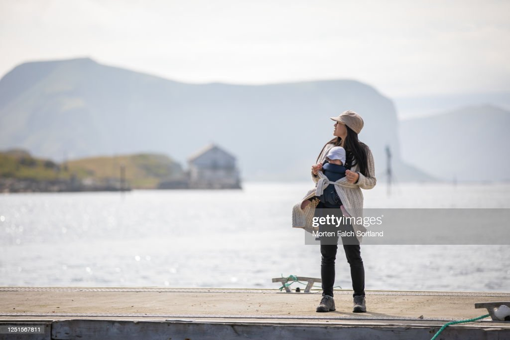Mommy And Baby Hanging Out On A Pier In Røst Norway High ...