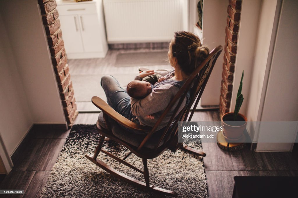 Mommy and baby in a rocking chair : Stock Photo
