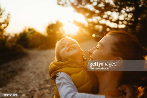 mommy and little boy in the nature - simple living stock pictures, royalty-free photos & images