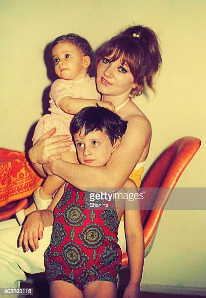 mommy hugging her children - filmato d'archivio foto e immagini stock